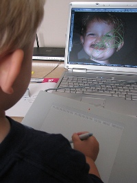 kid playing with wacom tablet
