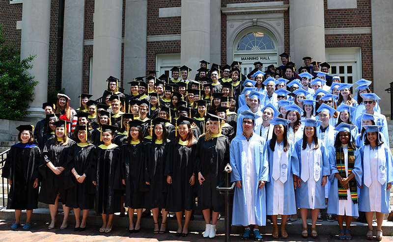 SILS graduates on the steps of Manning Hall