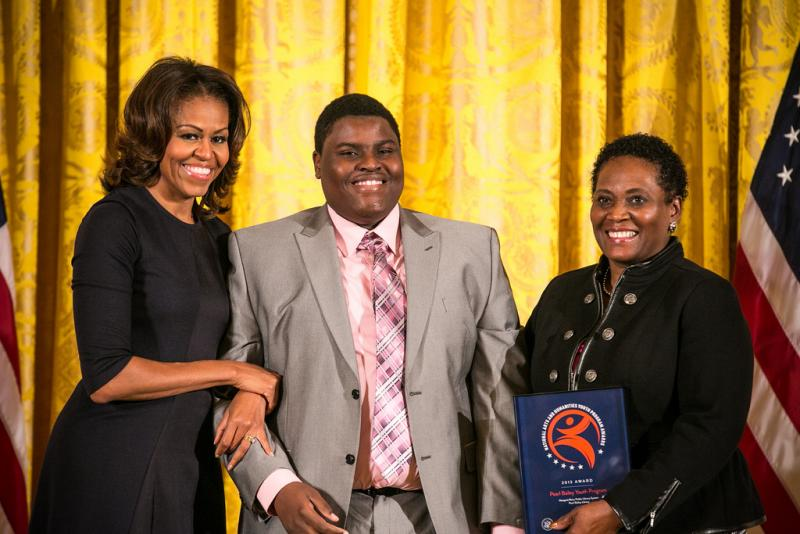Demetria Tucker receives award from First Lady Michelle Obama