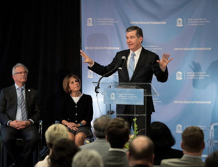 NC Governor Roy Cooper at podium.